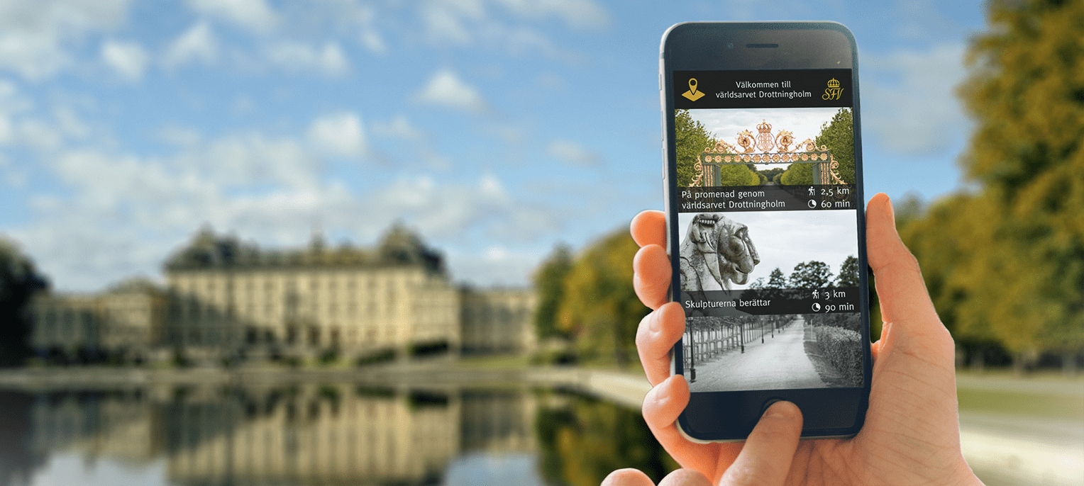 Hand holding mobile phone showing guide to Drottningholm