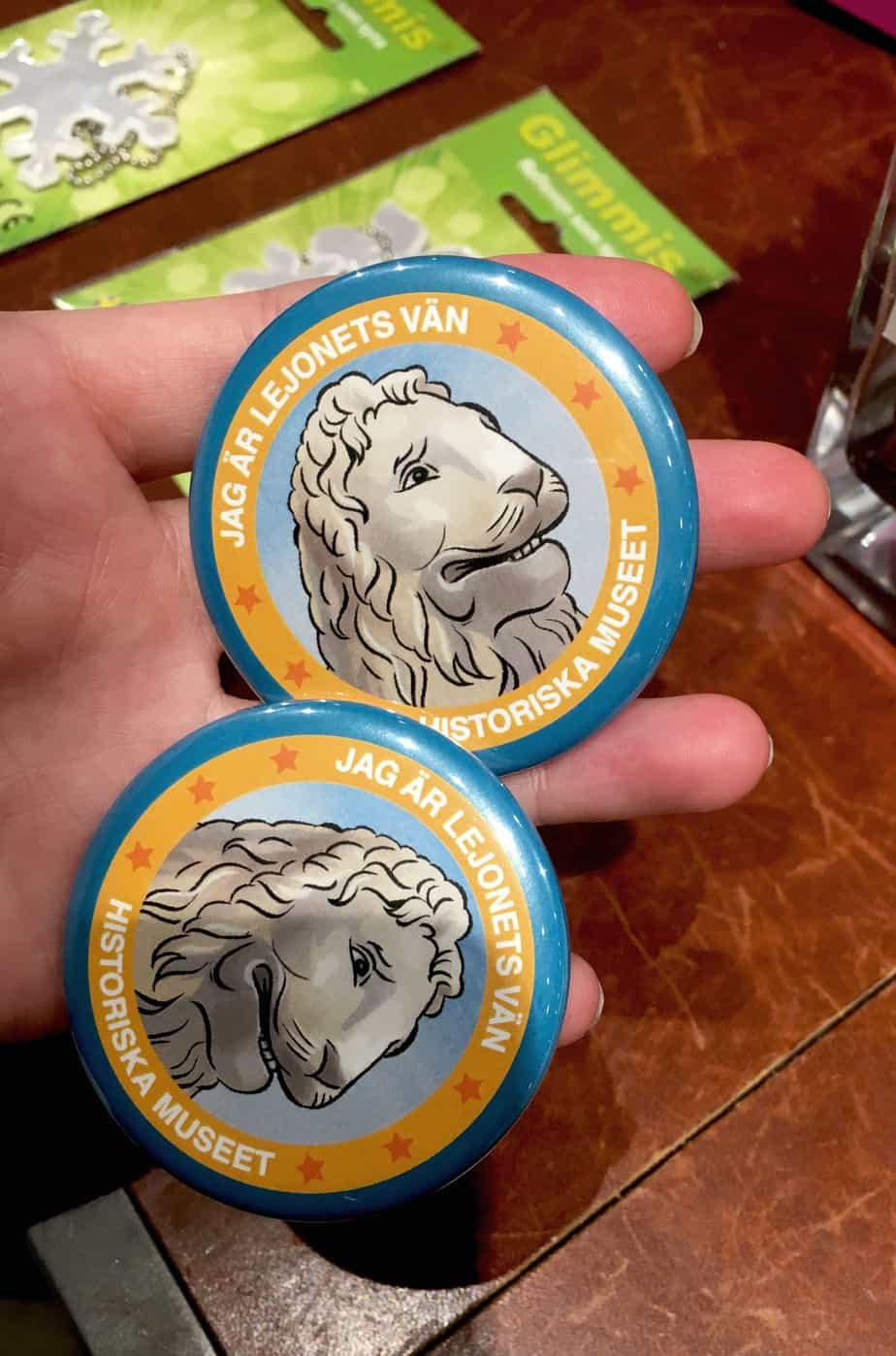 two badges with illustrated lions